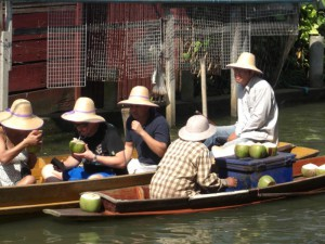 Foreign Tourists Drinking Coconut Juice