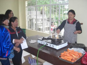 Trainer Showing How to Make Carrot Cake
