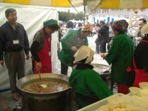Members Serving Local Soup at Festival in Yokohama, Japan