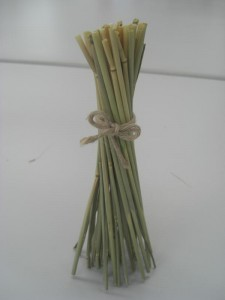 Bundle 15 to 20 stalks with a string placed just higher than the center.