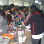 Women Learning How to Make Carrot Cake