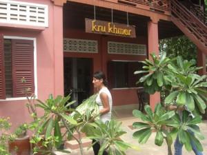 (A JVC staff member bringing lemon grass to Kru Khmer)